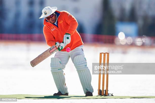 A player bats during the 30th Cricket on Ice tournament held on the frozen surface of the Lake St Moritz on February 25 2017 The tournament first...