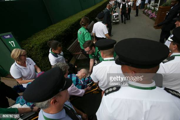 US player Bethanie MattekSands is carried on a stretcher to an ambulance after suffering an injury during her women's singles second round match...