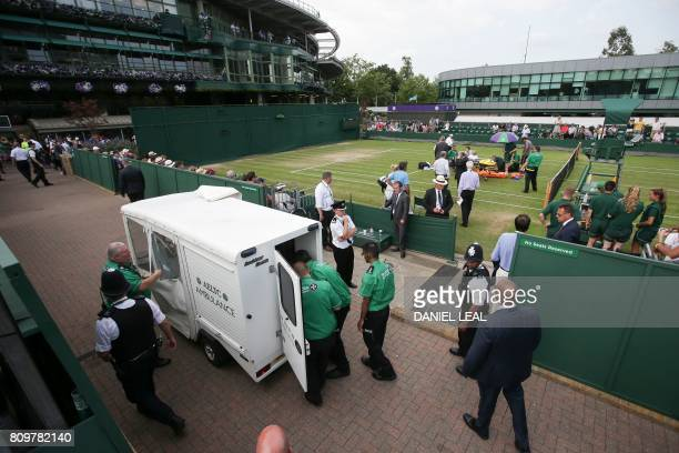 US player Bethanie MattekSands is helped by medics on the court as an ambulance is readied to take her after suffering an injury during her women's...