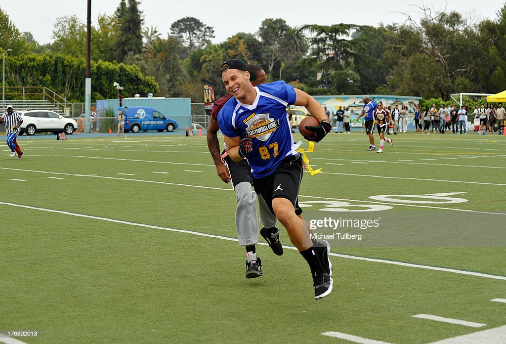 NBA player <a gi-track='captionPersonalityLinkClicked' href=/galleries/search?phrase=Blake+Griffin&family=editorial&specificpeople=4216010 ng-click='$event.stopPropagation()'>Blake Griffin</a> plays at the First Annual Celebrity Flag Football Game on August 18, 2013 in Pacific Palisades, California.