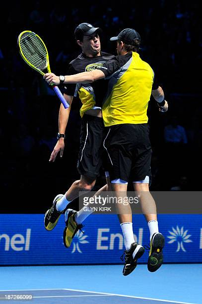 US player Bob Bryan and his partner US player Mike Bryan do their trademark chest bump celebration after beating Pakistan's AisamUlHaq Qureshi and...