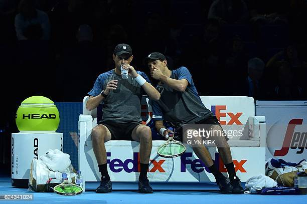 US player Bob Bryan and US player Mike Bryan sit between games against Finland's Henri Kontinen and his partner Australia's John Peers during their...