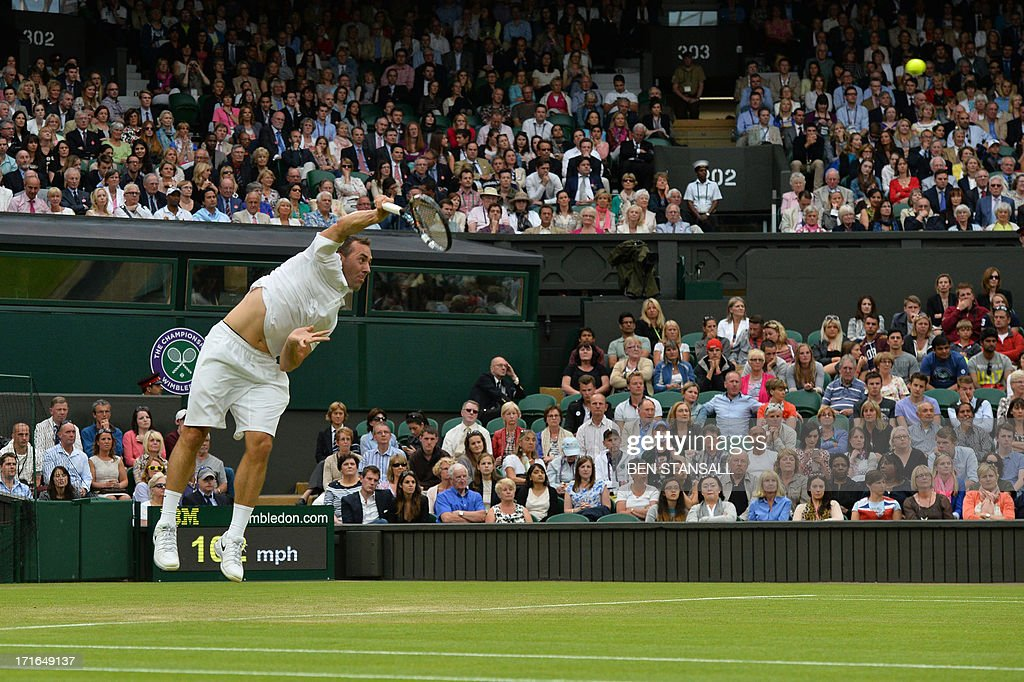 US player Bobby Reynolds serves against Serbia's Novak Djokovic during their second round men's singles match on day four of the 2013 Wimbledon Championships tennis tournament at the All England Club in Wimbledon, southwest London, on June 27, 2013.