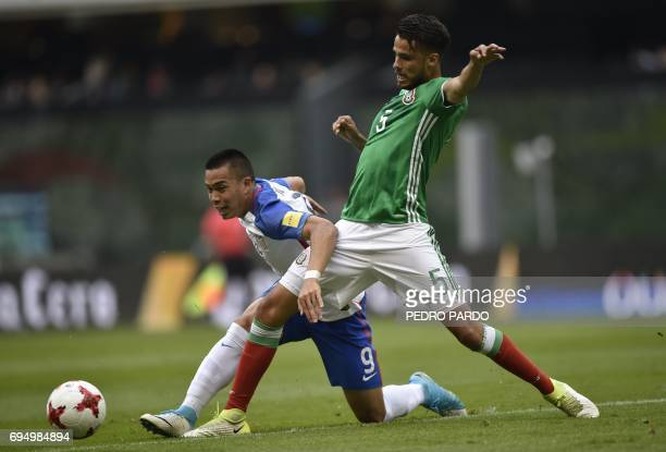 US' player Bobby Wood vies with Mexico's Diego Antonio Reyes during their 2018 FIFA World Cup Concacaf qualifier football match in Mexico City on...