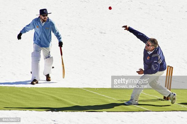 A player bowls during the 30th Cricket on Ice tournament held on the frozen surface of the Lake St Moritz on February 25 2017 The tournament first...