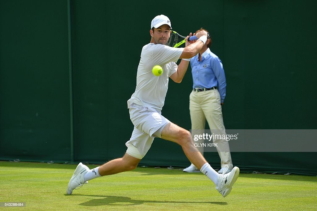US player Brian Baker returns against Croatia's Marin Cilic during their men's singles first round match on the first day of the 2016 Wimbledon Championships at The All England Lawn Tennis Club in Wimbledon, southwest London, on June 27, 2016. / AFP / GLYN