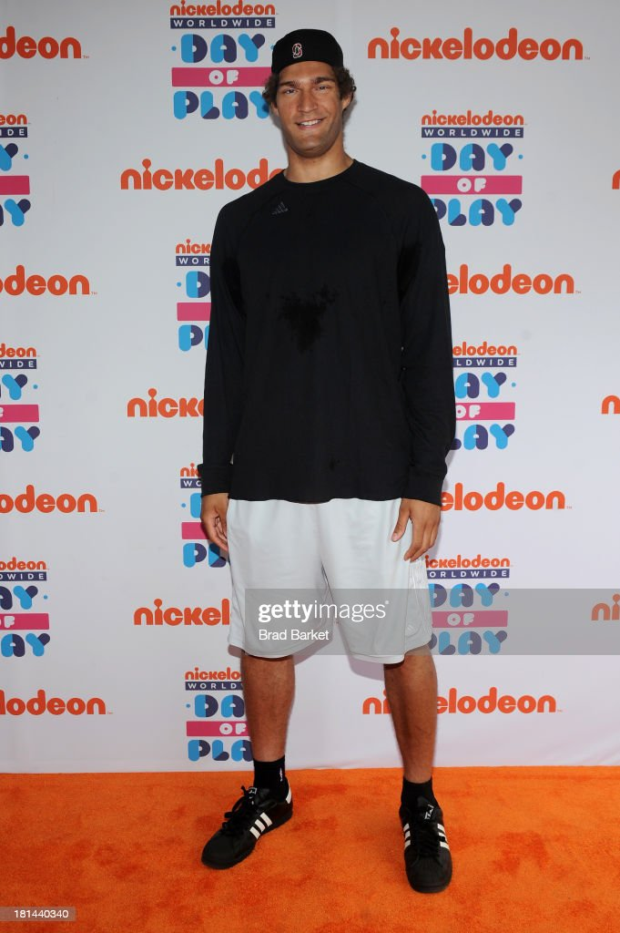 """NBA player Brook Lopez walks the """"orange"""" carpet for the 10th Annual Worldwide Day of Play at Prospect Park on September 21 2013 in New York City"""