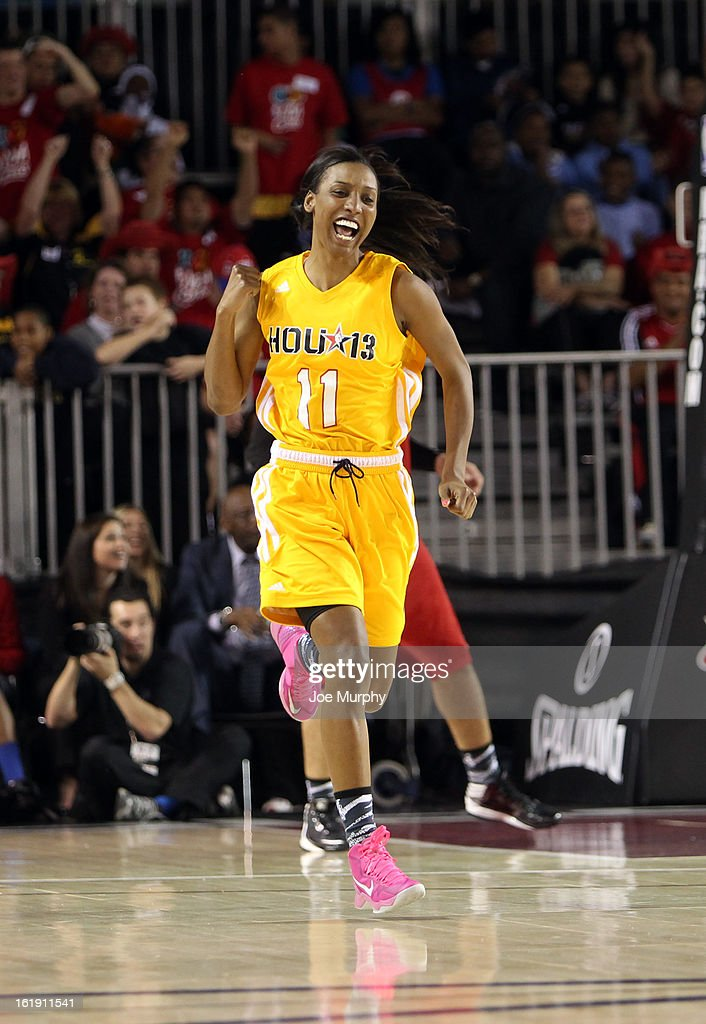WNBA player Candice Wiggins cheers during the NBA Cares Special Olympics Unity Sports Basketball Game on Center Court during the 2013 NBA Jam Session on February 17, 2013 at the George R. Brown Convention Center in Houston, Texas.
