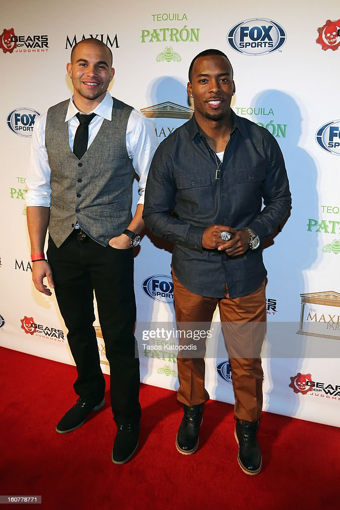 NFL player Carl Banks and Andrew Hawkins attend The Maxim Party With 'Gears of War: Judgment' For XBOX 360, FOX Sports & Starter Presented by Patron Tequila at Second Line Warehouse on February 1, 2013 in New Orleans, Louisiana.