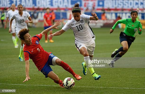 USA player Carli Llyod drives past South Korea's Kim Hyeri during a friendly match between the USA and South Korea at Red Bulls Arena in Harrison New...
