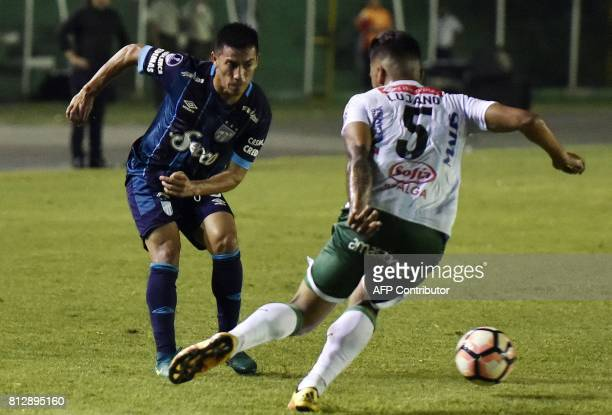 Player Carlos Javier Lujano of Bolivia's Oriente Petrolero vies for the ball with Guillermo Acosta of Argentina's Atletico Tucuman during their...