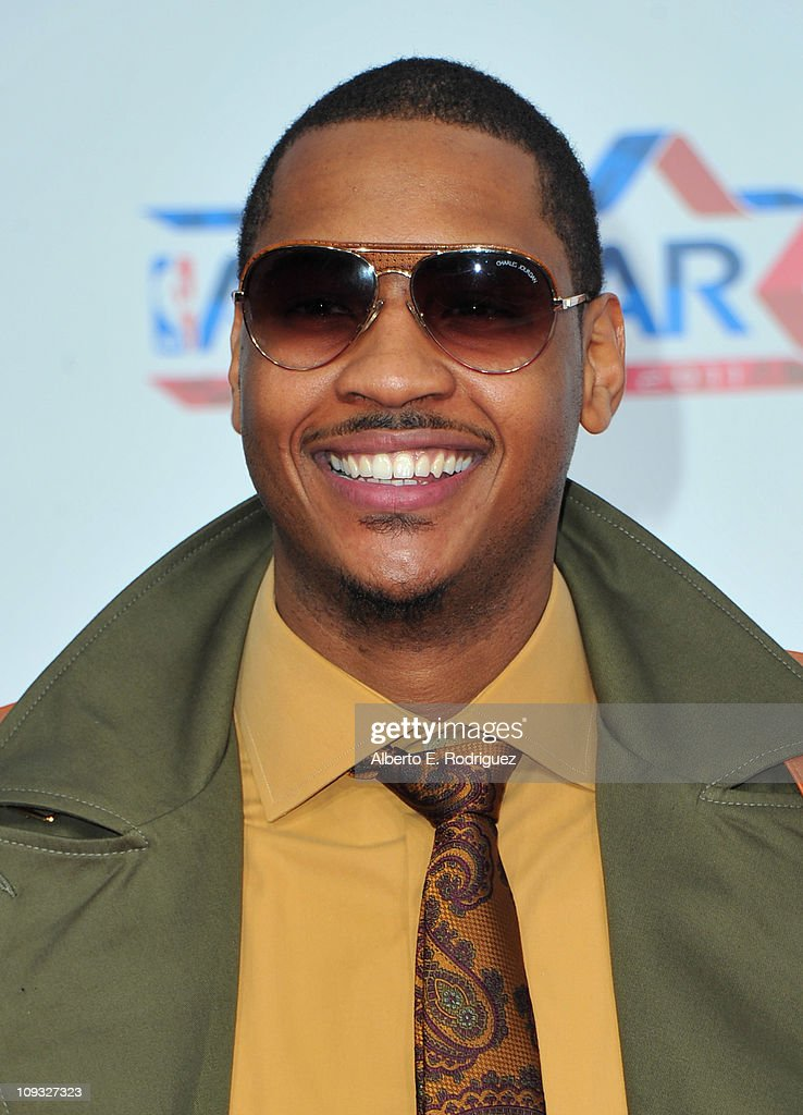 NBA player <a gi-track='captionPersonalityLinkClicked' href=/galleries/search?phrase=Carmelo+Anthony&family=editorial&specificpeople=201494 ng-click='$event.stopPropagation()'>Carmelo Anthony</a> arrives to the T-Mobile Magenta Carpet at the 2011 NBA All-Star Game on February 20, 2011 in Los Angeles, California.