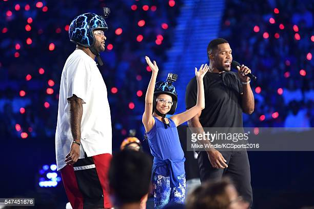 MLB player CC Sabathia actress Cree Cicchino and TV personality/retired NFL player Michael Strahan participate in a contest onstage during the...