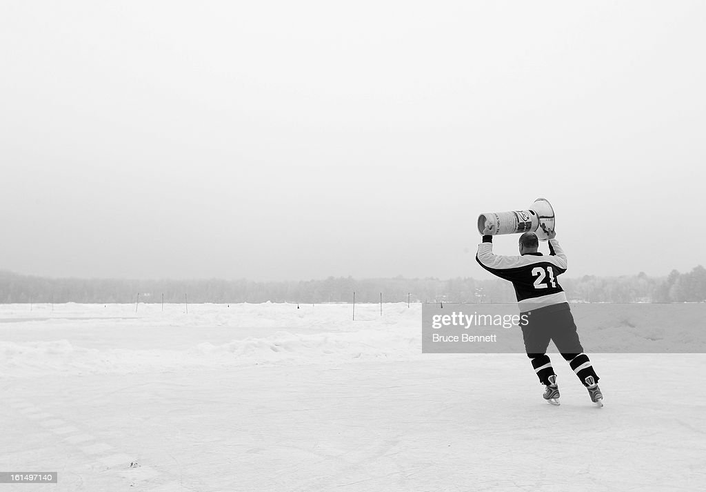 A player celebrates his victory in the 2013 USA Hockey Pond Hockey National Championships on February 10, 2013 in Eagle River, Wisconsin. The three day tournament features 2,400 participants from 30 states playing a round robin tournament on 28 rinks laid out on Dollar Lake.