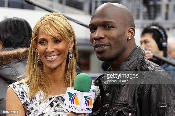 NFL player Chad Johnson is interviewed by TV personality Inez Sainz on the field during Super Bowl XLV Media Day ahead of Super Bowl XLV at Cowboys...