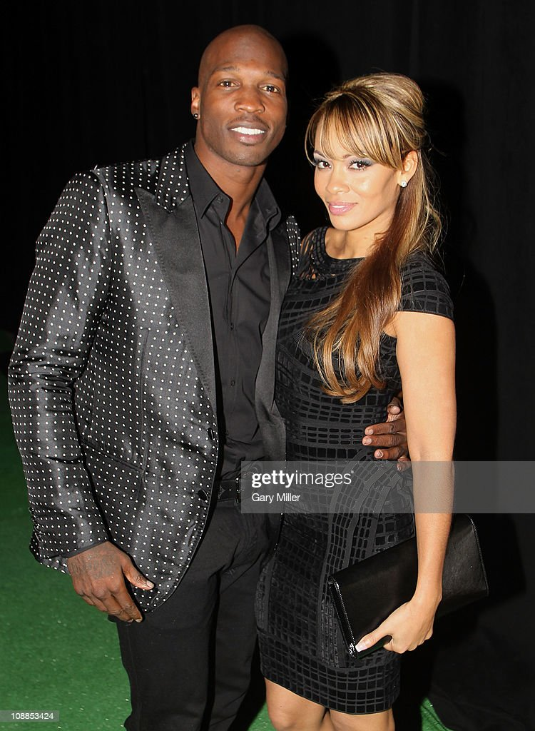 NFL player Chad Ochocinco and <a gi-track='captionPersonalityLinkClicked' href=/galleries/search?phrase=Evelyn+Lozada&family=editorial&specificpeople=6747068 ng-click='$event.stopPropagation()'>Evelyn Lozada</a> pose with Motorola Xoom at the Maxim Party Powered by Motorola Xoom at Centennial Hall at Fair Park on February 5, 2011 in Dallas, Texas.