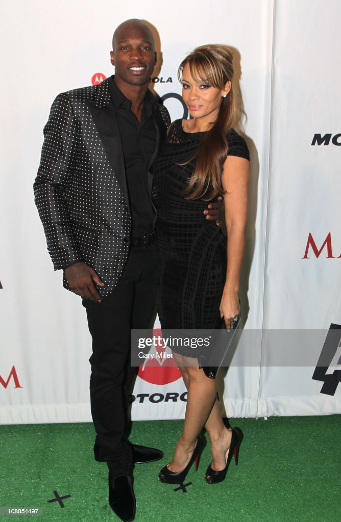 NFL player Chad Ochocinco and Evelyn Lozada pose with Motorola Xoom at the Maxim Party Powered by Motorola Xoom at Centennial Hall at Fair Park on February 5, 2011 in Dallas, Texas.