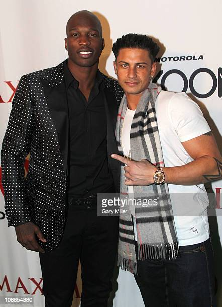 NFL player Chad Ochocinco and Paul 'Pauly D' DelVecchio pose with Motorola Xoom at the Maxim Party Powered by Motorola Xoom at Centennial Hall at...