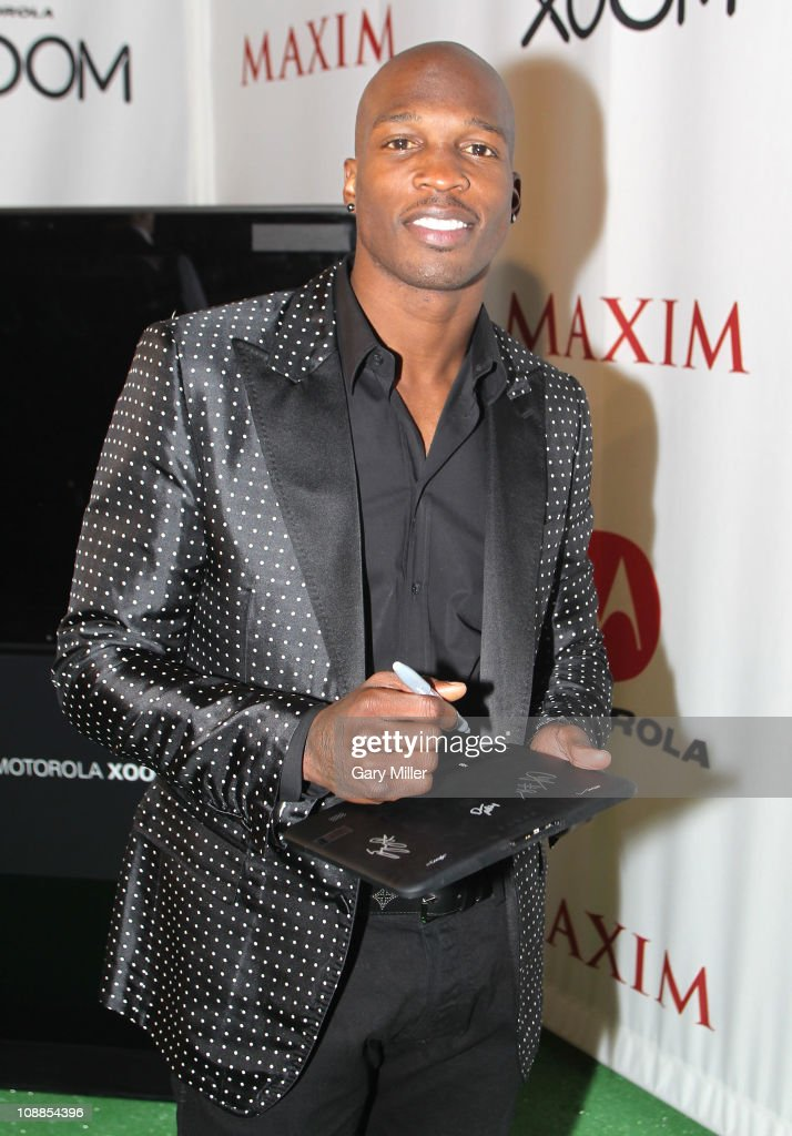 NFL player Chad Ochocinco poses with Motorola Xoom at the Maxim Party Powered by Motorola Xoom at Centennial Hall at Fair Park on February 5, 2011 in Dallas, Texas.