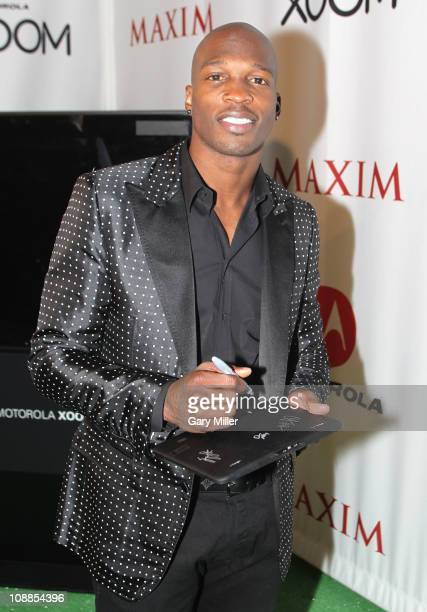 NFL player Chad Ochocinco poses with Motorola Xoom at the Maxim Party Powered by Motorola Xoom at Centennial Hall at Fair Park on February 5 2011 in...
