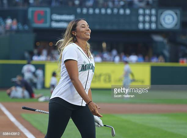 LPGA player Cheyenne Woods reacts to a shot at home plate on the field at Safeco Field prior to the start of the KPMG Women's PGA Championship at the...