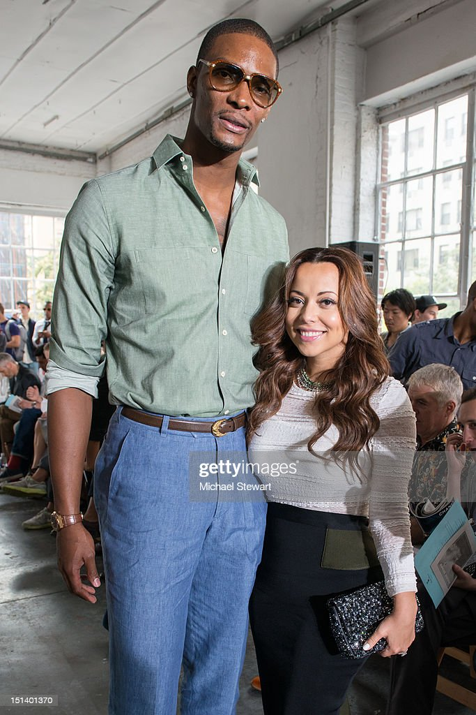 NBA player Chris Bosh and Adrienne Williams Bosh attend the Duckie Brown show during Spring 2013 MercedesBenz Fashion Week at Industria Superstudio...