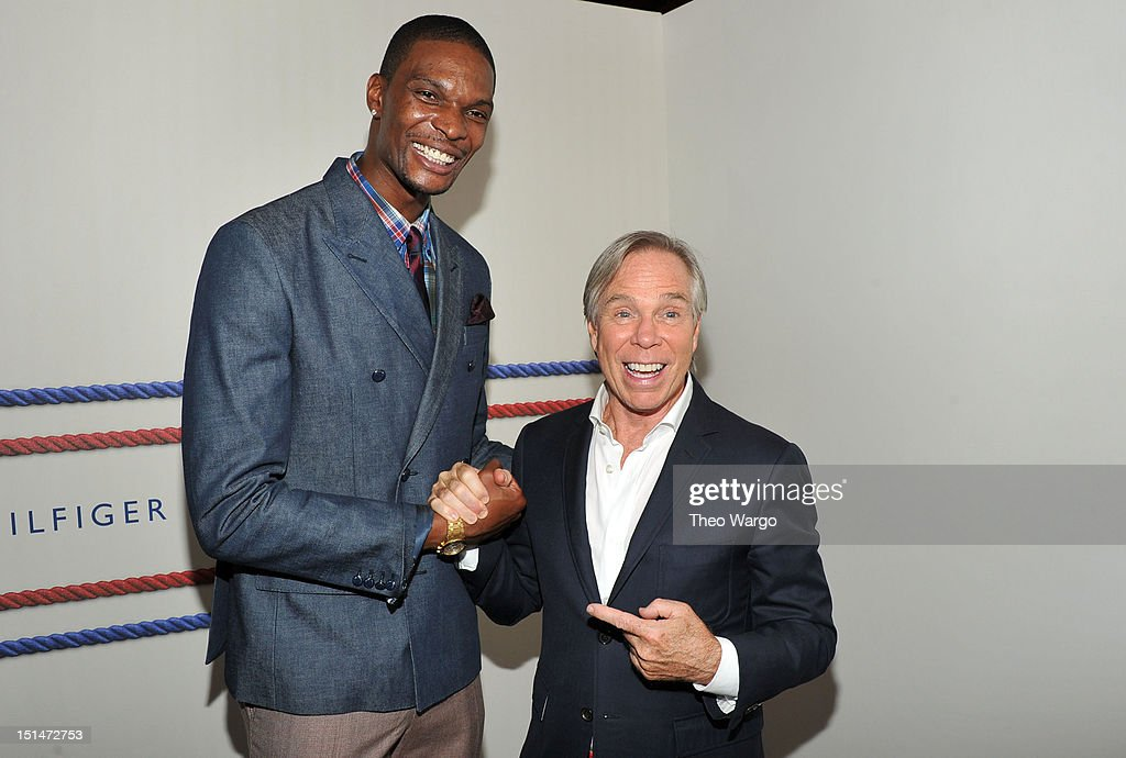 NBA player Chris Bosh and designer Tommy Hilfiger pose backstage at the Tommy Hilfiger Men's Spring 2013 fashion show during Mercedes-Benz Fashion Week at Maritime Hotel on September 7, 2012 in New York City.
