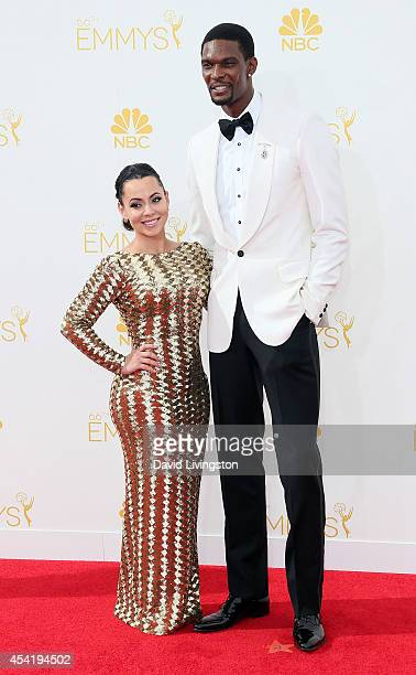 NBA player Chris Bosh and wife Adrienne Bosh attend the 66th Annual Primetime Emmy Awards at the Nokia Theatre LA Live on August 25 2014 in Los...