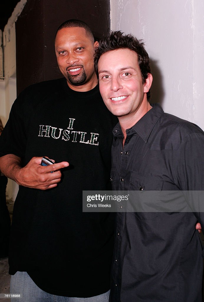 NBA player Chris Mills and Tommy Alastra attend artist Louis Carreon's showcase of Hollywood life collection entitled 'For the Love of Honey' at...