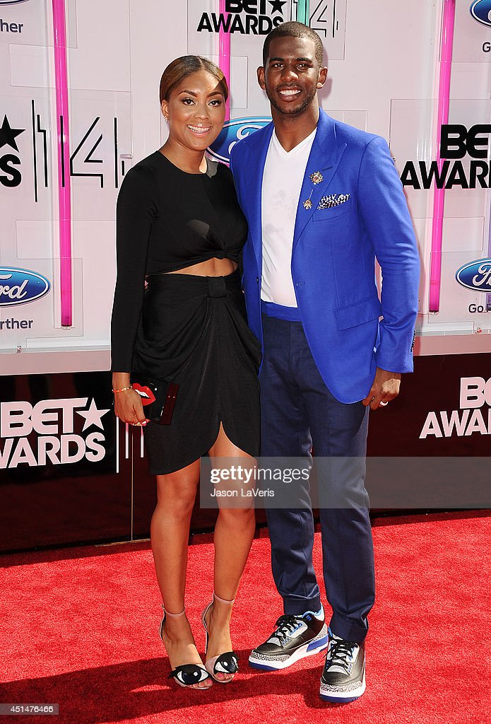 NBA player Chris Paul and wife Jada Crawley attend the 2014 BET Awards at Nokia Plaza LA LIVE on June 29 2014 in Los Angeles California