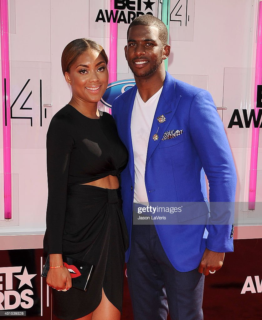 NBA player <a gi-track='captionPersonalityLinkClicked' href=/galleries/search?phrase=Chris+Paul&family=editorial&specificpeople=212762 ng-click='$event.stopPropagation()'>Chris Paul</a> (R) and wife Jada Crawley attend the 2014 BET Awards at Nokia Plaza L.A. LIVE on June 29, 2014 in Los Angeles, California.