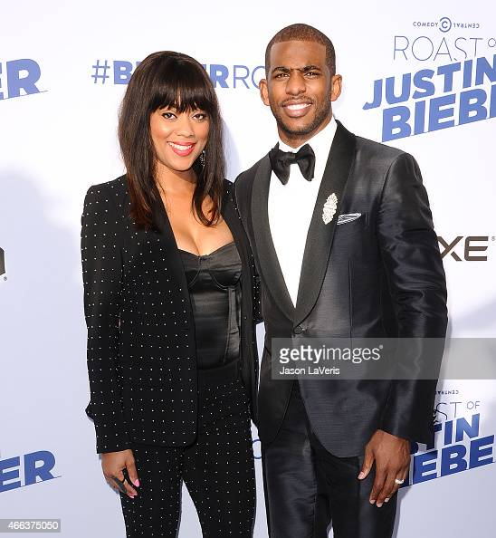 NBA player Chris Paul and wife Jada Crawley attend the Comedy Central Roast Of Justin Bieber on March 14 2015 in Los Angeles California