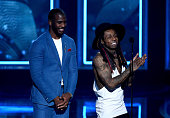 NBA player Chris Paul of the Los Angeles Clippers and rapper Lil' Wayne speak onstage during The Players' Awards presented by BET at the Rio Hotel...