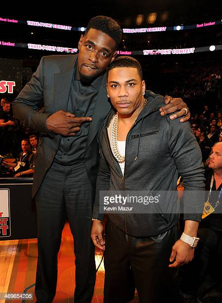 Player Chris Webber and Nelly attend the State Farm AllStar Saturday Night during the NBA AllStar Weekend 2014 at The Smoothie King Center on...