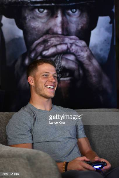 NFL player Christian McCaffrey of the Carolina Panthers sits down to play 'Call of Duty WWII' during its first beta via livestream at The Westin...