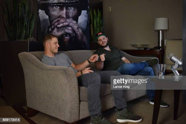 NFL player Christian McCaffrey of the Carolina Panthers sits down with Jordan 'LEGIQN' Payton to play 'Call of Duty WWII' during its first beta via...