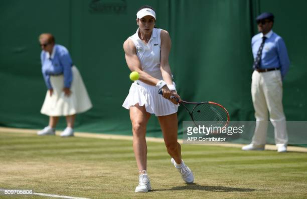 US player Christina McHale returns against Poland's Agnieszka Radwanska during their women's singles second round match on the fourth day of the 2017...