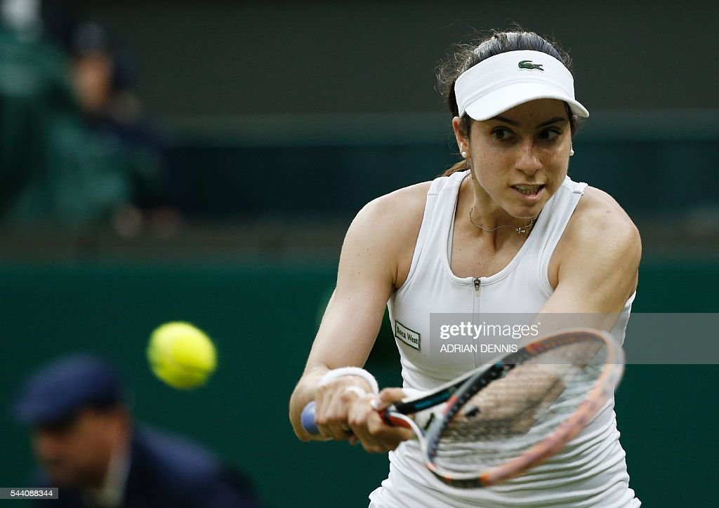 US player Christina McHale returns to US player Serena Williams during their women's singles second round match on the fifth day of the 2016 Wimbledon Championships at The All England Lawn Tennis Club in Wimbledon, southwest London, on July 1, 2016. / AFP / ADRIAN