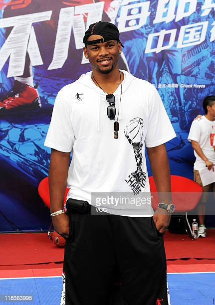 NBA player Chuck Hayes of Houston Rockets attends a promotional event of Qiaodan Sports Co Ltd on July 6 2011 in Xiamen Fujian Province of China