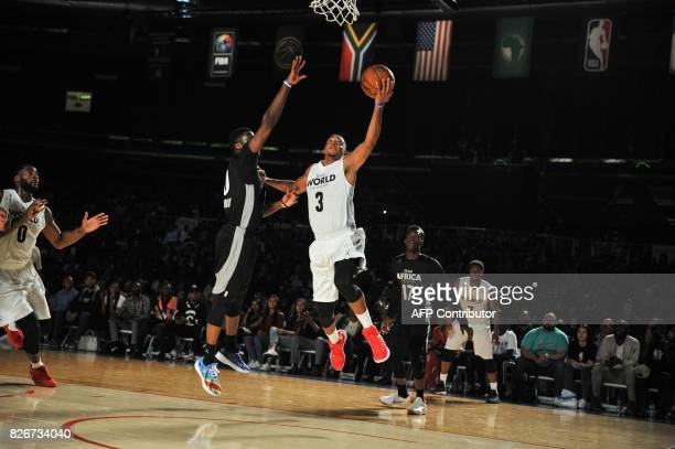 NBA player CJ McCollum from the Portland Trailblazers vies during the NBA Africa Game 2017 basketball match between Team Africa and Team World on...