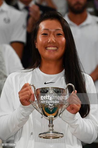 US player Claire Liu holds the trophy after winning against US player Ann Li during their girl's singles final match on the twelfth day of the 2017...