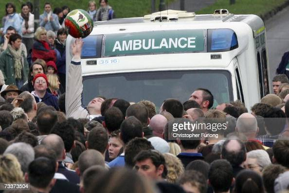A player clears the ball as an ambulance tries to make it's way to an injured competitor as the Up'ards and Down'ards battle for the ball in the...