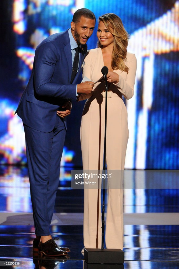 NFL player <a gi-track='captionPersonalityLinkClicked' href=/galleries/search?phrase=Colin+Kaepernick&family=editorial&specificpeople=5525694 ng-click='$event.stopPropagation()'>Colin Kaepernick</a> and model Chrissy Teigen speak onstage during the 2014 ESPYS at Nokia Theatre L.A. Live on July 16, 2014 in Los Angeles, California.