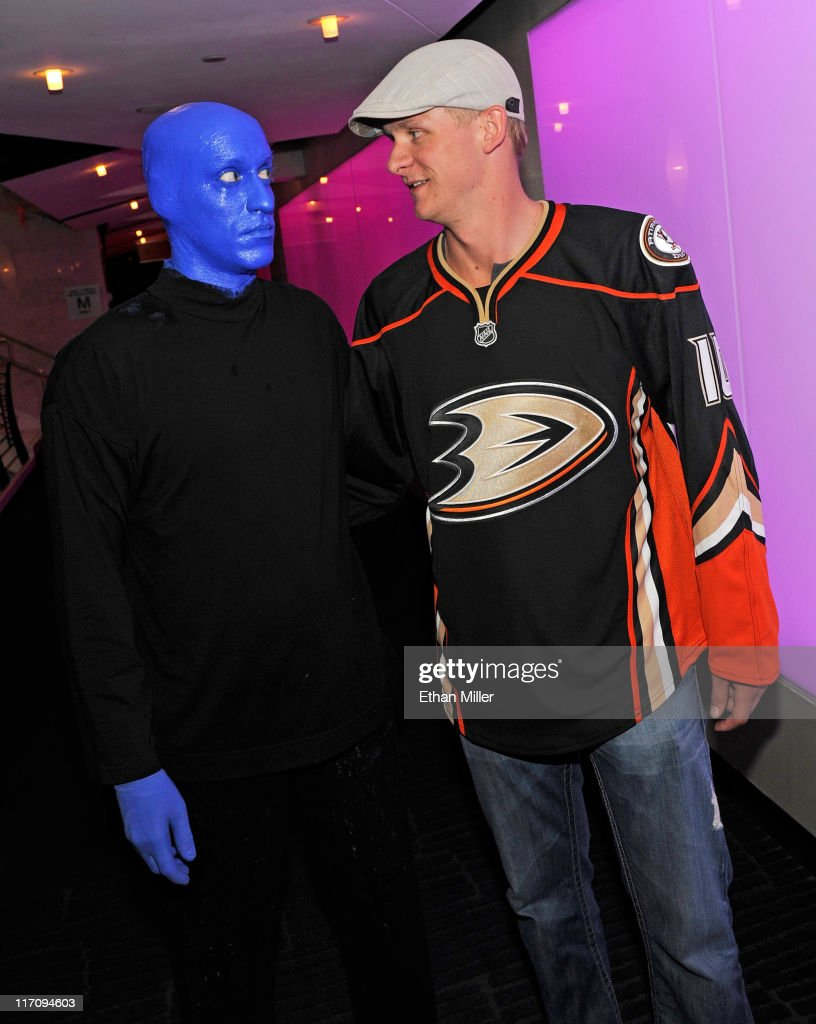 NHL player Corey Perry (R) of the Anaheim Ducks appears with a member of Blue Man Group at The Venetian June 21, 2011 in Las Vegas, Nevada.