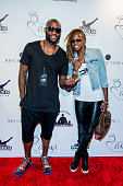 NBA player Corey Williams and sprinter Dominique Blake attends the 2016 Roc Nation Summer Classic Charity Basketball Tournament at Barclays Center of...
