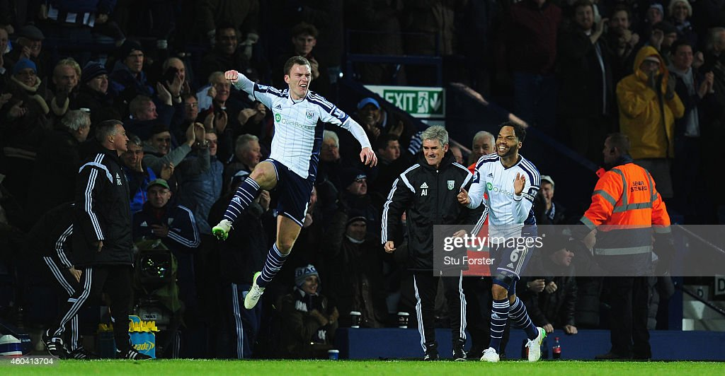 WBA player <a gi-track='captionPersonalityLinkClicked' href=/galleries/search?phrase=Craig+Gardner&family=editorial&specificpeople=685283 ng-click='$event.stopPropagation()'>Craig Gardner</a> (l) celebrates his goal with manager Alan Irvine and Joleon Lescott (r) during the Barclays Premier League match between West Bromwich Albion and Aston Villa at The Hawthorns on December 13, 2014 in West Bromwich, England.