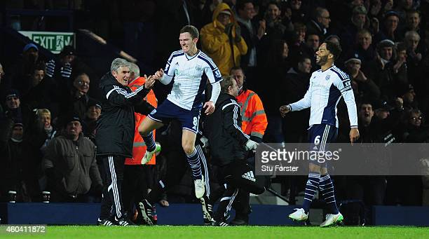 WBA player Craig Gardner celebrates his goal with manager Alan Irvine during the Barclays Premier League match between West Bromwich Albion and Aston...