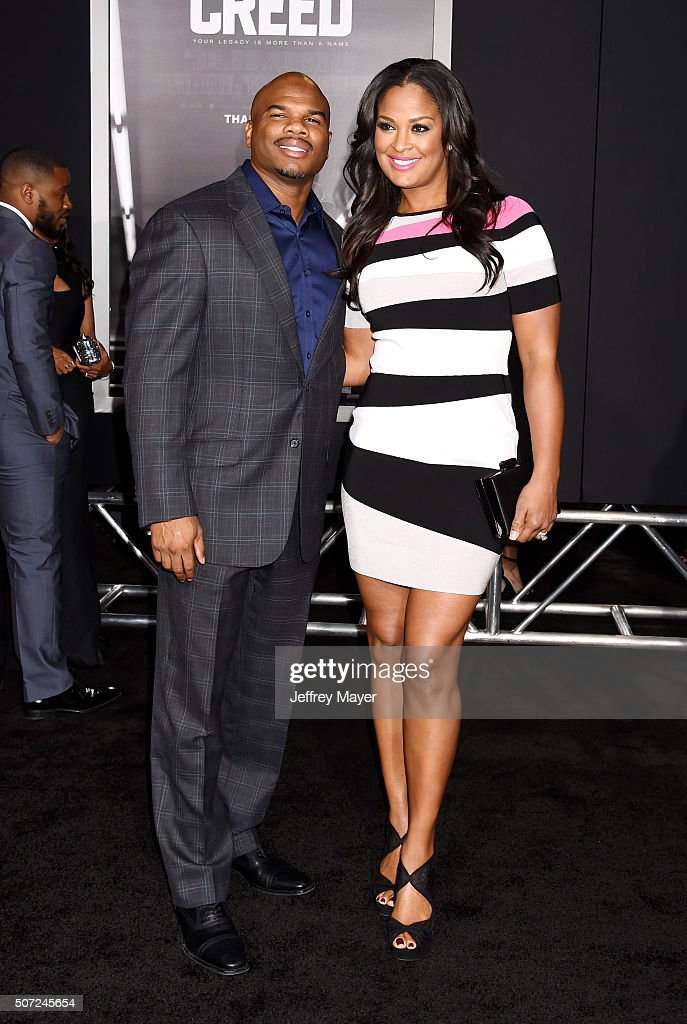 NFL player Curtis Conway and wife/professional boxer Laila Ali arrive at the premiere of Warner Bros Pictures' 'Creed' at Regency Village Theatre on...