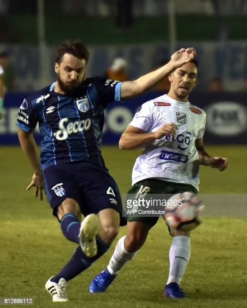 Player Damian Lizio of Oriente Petrolero of Bolivia vies for the ball with Ignacio Canuto of Atletico Tucuman of Argentina during their Sudamericana...