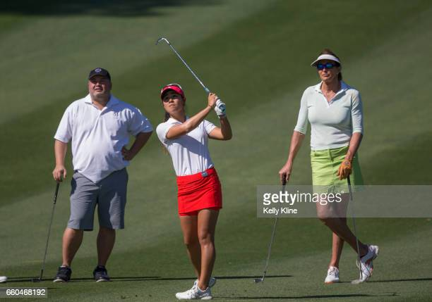 LPGA player Danielle Kang hits from the fairway of the 9th hole as Caitlyn Jenner watches during the ANA Inspiration ProAm at Mission Hills Country...